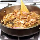 frying pan, sautoir, sliced onion