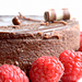 Chocolate cheesecake with ganache and raspberries