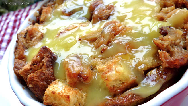 Rum Raisin Bread Pudding with Warm Vanilla Sauce