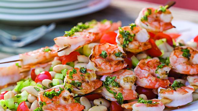 Grilled Shrimp Skewers over White Beans