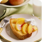 'Peach Cream Pie II Recipe -   A mixture of flour, cinnamon, nutmeg and sugar is sprinkled in the bottom of a prepared pie shell. Sliced peaches are piled in, and more sugar is sprinkled on top. Heavy cream is then poured over the peaches, and this heavenly pie is baked until the peaches are tender.' from the web at 'http://images.media-allrecipes.com/images/7080.jpg'