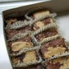 Chocolate Revel Bars Recipe - Chewy, bar type cookies loaded with fudgy filling. A family favorite.