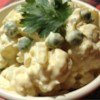 Cauliflower Salad Recipe - This is a wonderful option for picnics and grill outs when you are looking for a new take on potato salad. This simple side salad made with cauliflower, peas, and hard boiled eggs can be made the day ahead and chilled until party time!