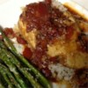Chicken Breasts Pierre Recipe - Chicken steeped in a sweet and savory blend of tomatoes, spices and herbs.  Serve with crusty French bread to mop up every last drop.