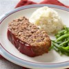 Brown Sugar-Glazed Home-Style Meat Loaf Recipe - This classic meatloaf is topped with a ketchup-brown sugar glaze halfway through baking for a tangy flavor boost.