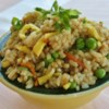 Fried Rice I Recipe - White rice is fried with eggs, bacon, soy sauce, green peas and green onions.