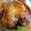 Drunken Chicken Recipe - This is a wild one: A whole chicken is smeared with Dijon mustard, then grilled over a can filled with beer and Italian dressing!
