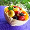Honey Lime Fruit Salad Recipe - Seasonal fruit is drizzled with honey and lime juice and tossed with pine nuts for a special treat for parties or family gatherings.