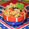 Kerry's Beany Salad Recipe - Red and black beans join barley, rice, peppers, and green onions in this robust salad, dressed with a fiery vinegar and oil dressing. Makes a great side dish for ribs or a grilled steak.
