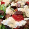 Bob's Blue Cheese Dressing Recipe - Prepare a flavorful summer salad by serving this dressing over mixed mesclun greens, hearts of romaine, sliced cucumber, tomato and red onion.