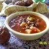 Slow Cooker Beef Vegetable Soup Recipe - Cans of carrots, corn, green beans, potatoes and tomatoes are combined in a slow cooker with stew meat and onion soup mix in this recipe for a one dish meal.  Allow 6 hours cooking time.