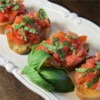 Bruschetta with Shallots Recipe - Shallots are the special ingredient in this easy, filling bruschetta. The tomato mixture tastes best when prepared ahead of time and chilled for approximately 1 hour.