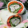 Easy Snack Wraps Recipe - So easy to make, these bite sized wraps filled with turkey, cream cheese and veggies are a great way to fill up an appetizer tray - and your hungry guests' bellies.
