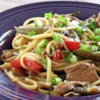 Pork Lo Mein Recipe - Pork and vegetables are stir-fried in a sesame oil sauce and tossed with linguine for a quick, Asian-inspired dinner.