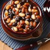 Apple Butter Baked Beans Recipe - Three kinds of beans are slowly baked in a sweet and zesty sauce of apple butter, ketchup, honey, and spices.