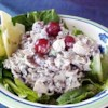 Wild Rice Salad Recipe - Nutty wild rice combines with tender turkey, sweet grapes, crunchy almonds and a light, creamy dressing in this wonderful salad.