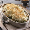 Mashed Potato Topped Green Bean Casserole Recipe - Classic green bean casserole is topped with mashed potatoes, toasted under the broiler, then topped with French fried onions.