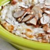 Martha's Hot Almond Spread Recipe - Sliced almonds garnish this hot cheese mixture before it goes in the oven--the result is a pleasant crunch that accompanies every bite.