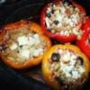 Nick's Feta and Artichoke Stuffed Peppers Recipe - Artichoke hearts, feta cheese, and brown rice make these stuffed peppers a little different than the typical recipe.
