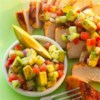 Cumin Rubbed Chicken with Avocado Salsa Recipe - Browned chicken breasts with cumin are served with a chunky salsa made with avocado, cucumber, tomato and fresh cilantro.