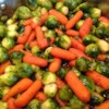 Baby Carrots And Brussels Sprouts Glazed With Brown Sugar and Pepper Recipe - The vegetables can be prepared the day before, and the glaze can be prepared up to 6 hours in advance.  The dish can then be completed in a few minutes while the turkey is resting.  It all looks so effortless. Originally submitted to ThanksgivingRecipe.com.