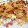 Apple Raisin French Toast Strata Recipe - A simple but elegant way to make breakfast fast. Put together the night before, and bake while you're in the shower. Serve with lots of extra maple syrup! You may also add extra raisins if you wish.