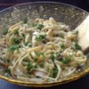 Lighter Chicken Fettuccine Alfredo Recipe and Video - This version of chicken fettuccine alfredo is lightened by substituting some of the heavy cream with chicken broth.