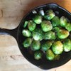 Pan Fried Brussels Sprouts Recipe - Put away your sad memories of boiled Brussels sprouts. Pan fry them in hot olive oil with garlic and onion, and they turn golden brown, with crispy edges and a sweet, nutty flavor that will become addictive.