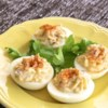 Classic Deviled Eggs Recipe - Finely chopped celery and onion give these classic deviled eggs a nice crunch.