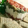 Dip For The Stars Recipe - A delectable layered dip for any special occasion made with feta and cream cheese, pesto, pine nuts and sun-dried tomatoes. Looks beautiful on the table, tastes heavenly on your tongue!
