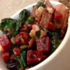 Fresh Beet Salad Recipe - Bacon, beets, Swiss chard, peas, and feta cheese are all you need to make this unique salad.