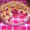 Raspberry Pie II Recipe -  Just over two cups of raspberries are heaped into a pie crust, sprinkled with lots of brown sugar and a bit of cornstarch for thickening, and dotted with butter. The top crust goes on, and then this luscious pie is slipped into a hot oven to bake.