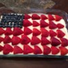 No-Bake Cheesecake Flag Cake  Recipe and Video - This no-bake cheesecake has a light texture that's less dense than baked cheesecake. The filling stars cream cheese, rich mascarpone cheese, and fresh whipped cream, which you'll combine and spread over a homemade chocolate graham cracker crust. Make the stars and stripes with fresh strawberries and blueberries. It's so easy!