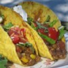 Tasty Lentil Tacos Recipe - This fun taco dish is both healthy and delicious. It will be a hit with the entire family! Serve with your favorite taco fillings, such as sour cream, chopped tomatoes, shredded lettuce, and Cheddar cheese.