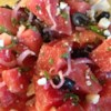 Watermelon Summer Salad Recipe - Watermelon is tossed with onion, feta cheese and olives in this intriguing summer dish. Don't be scared by the ingredients, they work together to make a very tasty and refreshing salad. Go ahead and try it - be prepared for a pleasant surprise!