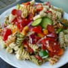 Pasta Salad with Homemade Dressing Recipe - This colorful pasta salad is packed with vegetables, pepperoni, and cheese. Toss with the simple dressing mixture, chill, and enjoy!