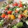 Thai Beef Salad Recipe - Seared and marinated beef is served atop a crisp lettuce and cucumber bed in this salad bursting with fresh Thai flavors.