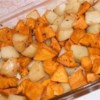 Roasted Potato Medley Recipe - Russet, red and sweet potatoes are roasted with olive oil, garlic and balsamic vinegar in this tasty low-fat side dish.