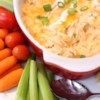 Healthier Buffalo Chicken Dip Recipe - Tangy, creamy, and spicy, this buffalo chicken dip is made healthier by using reduced-fat dairy ingredients.  Try serving with celery sticks and multi-grain crackers, for an even tastier treat.