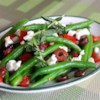Marinated Green Beans with Olives, Tomatoes, and Feta Recipe - Just like the name of the dish implies, this recipe makes a lovely side dish of green beans, kalamata olives, and tomatoes. These items are tossed with red wine vinegar, garlic, and oregano before being finished with a sprinkling of feta cheese. Allow the flavors to marinate together overnight for even better results.