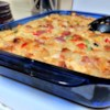 Cheesy Amish Breakfast Casserole Recipe and Video - This hearty casserole has bacon, eggs, hash browns, and three different cheeses all baked into a comforting breakfast dish, perfect for feeding a crowd.