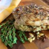 Pesto Stuffed Pork Chops Recipe - Bone-in pork chops are stuffed with feta cheese, basil, and pine nuts and baked with a balsamic vinegar glaze in an easy and quick family favorite main dish.