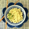 Paleo Cauliflower Rice Recipe - Cauliflower is processed into rice-shape pieces and cooked with oil creating a paleo-friendly cauliflower 'rice' side dish.