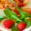 Spinach and Strawberry Salad Recipe and Video - This salad has lots of spinach, lots of fresh, sliced strawberries, and a delicious, sweetened oil and vinegar dressing spiked with poppy and sesame seeds.