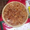 Chocolate Pecan Pie IV Recipe - Corn syrup makes this veritable pecan pie thick and sweet. Unsweetened chocolate makes it sensational. Serve warm or chilled.