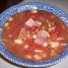 New Year's Day Black-Eyed Peas Recipe and Video - See in the new year with a hearty bowl of black-eyed peas cooked with garlic, onion, tomatoes and diced country ham. A real country ham is quite salty, but the flavor and seasoning is just right for this homey dish.