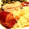 Pork Roast with Sauerkraut and Kielbasa Recipe - This is the traditional New Year's Day meal I learned from my husband, whose family originated in central Pennsylvania. It's wonderful, especially served with mashed potatoes and applesauce.