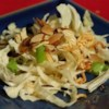 Asian Salad Recipe - For a sensational summer salad, toss shredded Napa cabbage and sliced green onions with toasted ramen noodles, slivered almonds and sesame seeds, then dress with an aromatic blend of oil, vinegar, sugar and soy sauce.