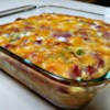 """Wake-Up Casserole Recipe - Hash brown potatoes, Cheddar cheese, ham, and eggs are baked together into a breakfast casserole cleverly named """"wake-up casserole""""."""
