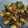Garlic Brussels Sprouts with Crispy Bacon Recipe - Pan-fry Brussels sprouts in butter and crispy bacon for a smoky addition to your vegetable side dish. You can add a little of the bacon grease to the dish if you prefer.